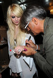 http://img197.imagevenue.com/loc1139/th_68122_Taylor_Momsen_perfoms_during_the_Teen_Vogue_Fashion0s_Night_Out_Fashion_Show_2090910_9_123_1139lo.jpg