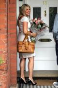 Holly Willoughby arrives back home with a big smile and flowers after her first day on 'This Morning' TV show- 15HQ